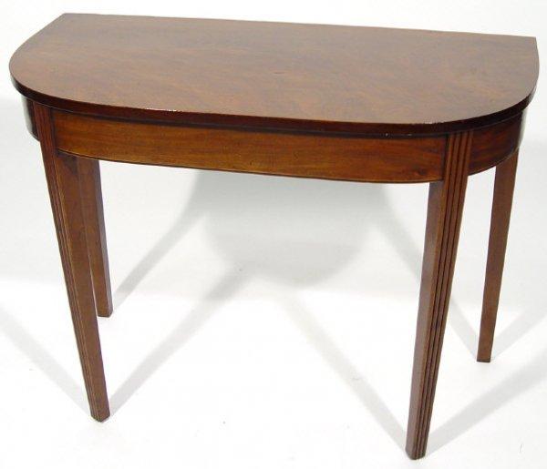 17: 19th Century mahogany demi-lune pier table raised b
