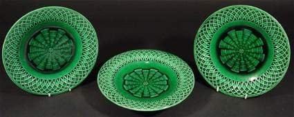 106 Two Minton Majolica green glazed plates and a matc