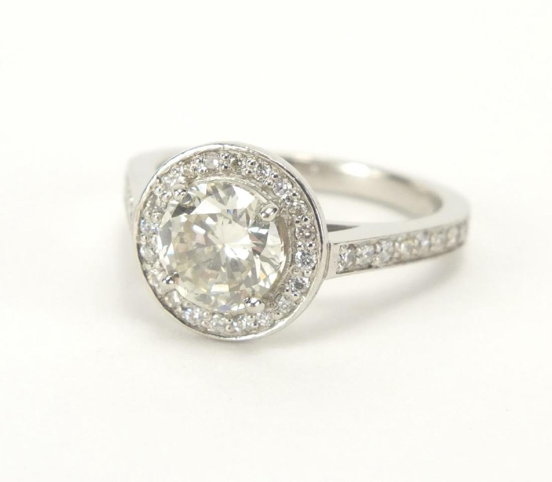 Platinum and diamond solitaire halo ring, size M,