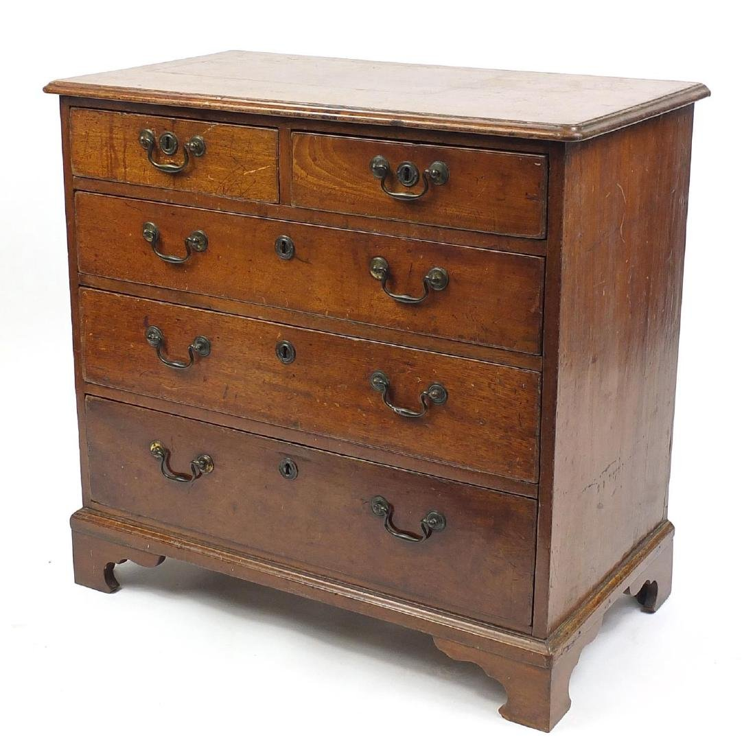 Georgian oak five drawer chest, fitted with two short
