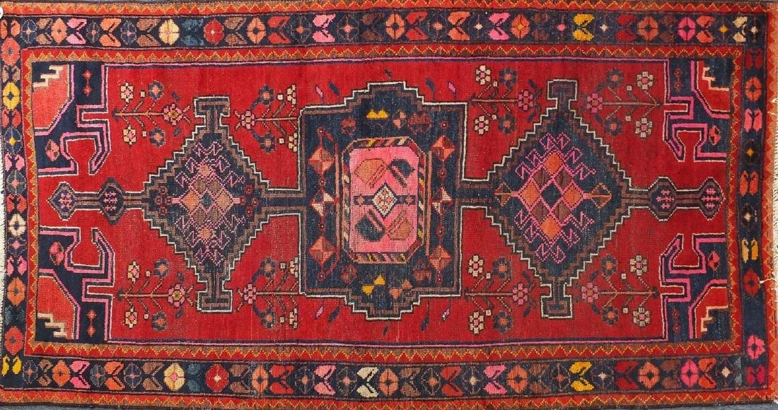 Rectangular Persian tribal rug, onto a red ground,