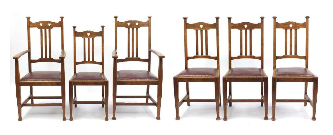 Set of six oak Arts & Crafts chairs including two