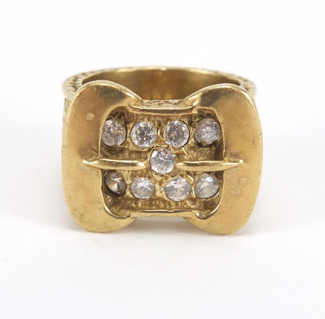 Heavy 9ct gold buckle ring, set with clear stones, size