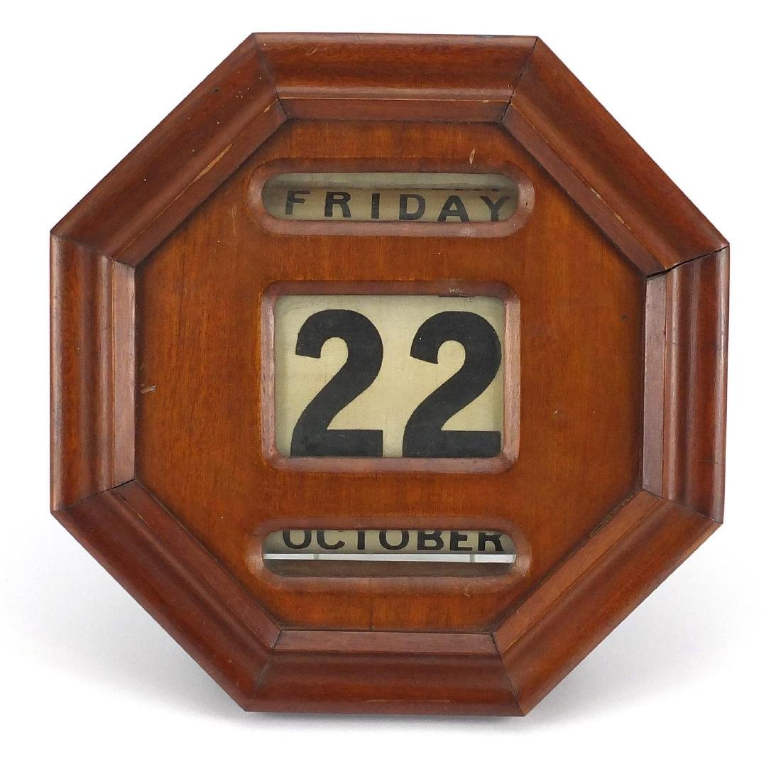 Victorian mahogany wall roller day date calendar with octagonal face, 31cm x 30cm Further