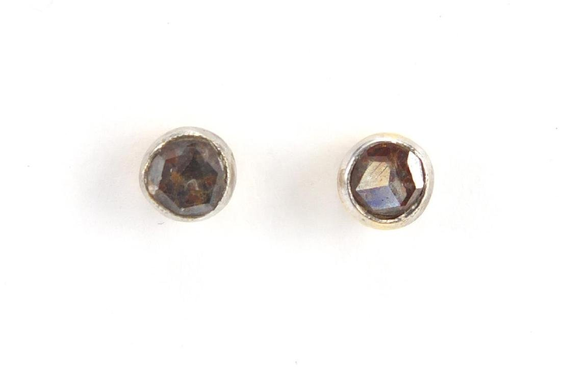Pair of 18ct gold Diamond solitaire earrings, EF London hallmark, approximate weight 1.0g Rough