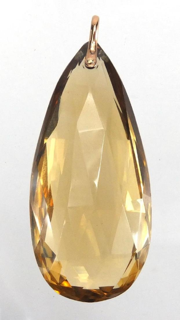 Large smoky Quartz tear drop pendant, with unmarked gold suspension loop, 6.5cm in length,
