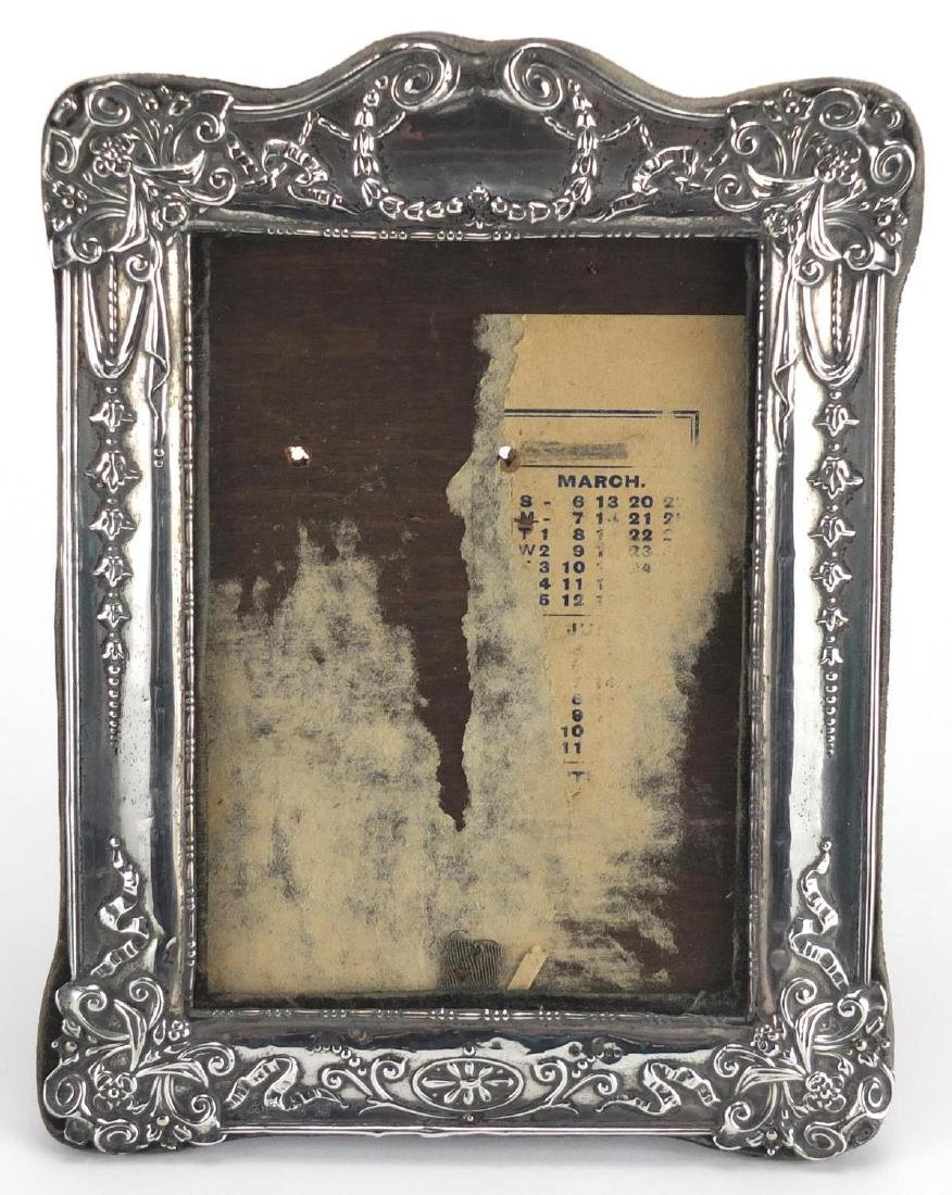 Silver easel photo frame, embossed with swags and flowers, VPDC Birmingham 1911, 19cm high Further
