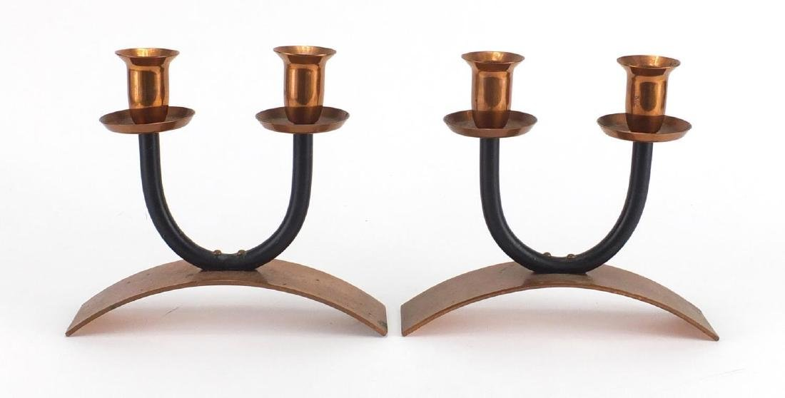 Pair of Modernist copper twin candlesticks, each 18cm high Further condition reports can be found at