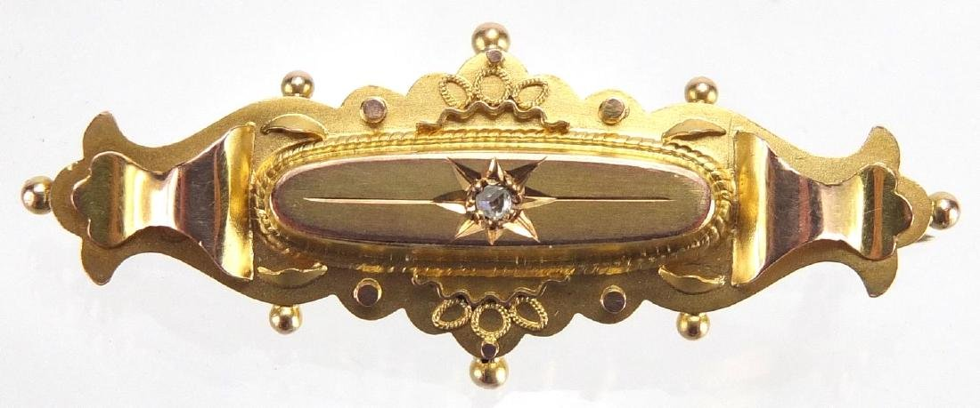 9ct gold Victorian style mourning brooch set with a diamond, 4.5cm in length The Diamond is old