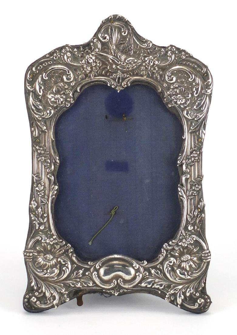 Victorian silver easel photo frame, embossed with a bird and flowers, Chester 1899, 21cm high