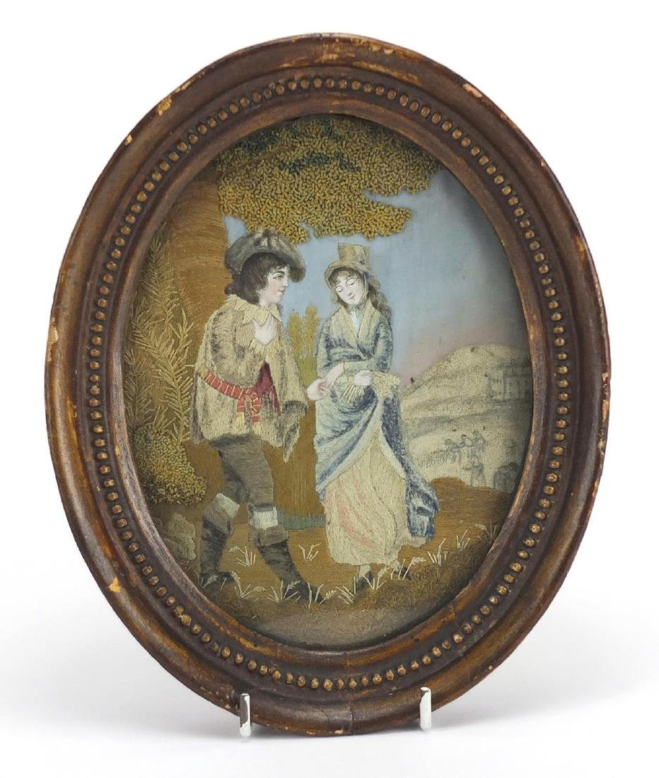 19th century oval silk work picture depicting two lovers, framed, 18cm x 13.5cm Further condition