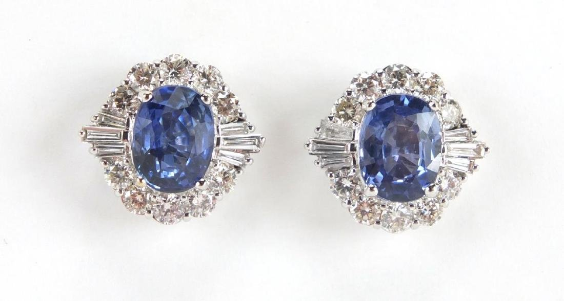 Pair of 18ct white gold Sapphire and Diamond cluster earrings Sapphire is oval faceted cut