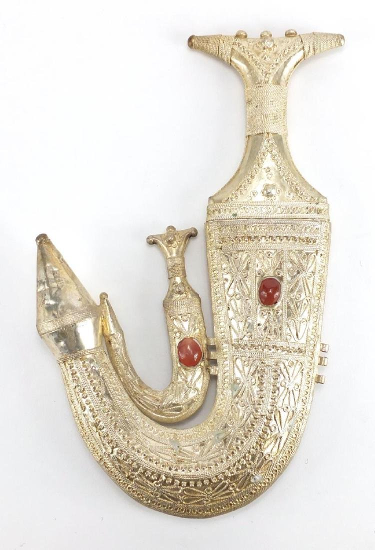 Middle Eastern silver coloured metal presentation plaque in the form of a Jambiya set with two red