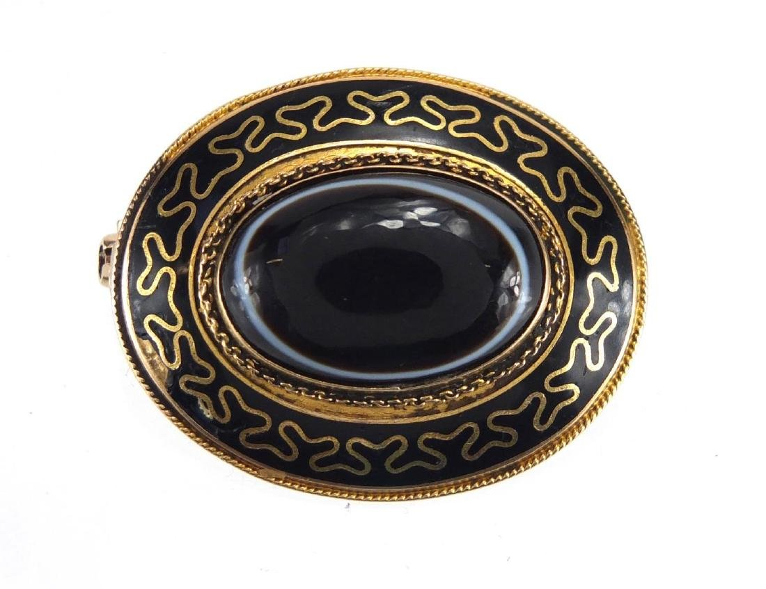 Victorian unmarked gold black enamel mourning brooch, set with a Cabochon Agate stone, 3.5cm in