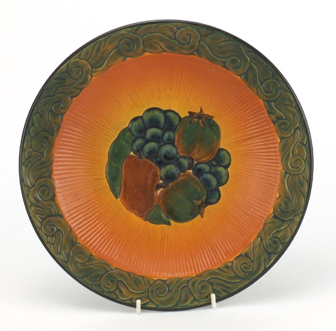 Danish pottery dish by Peter Ipsens Enke, hand painted and decorated in relief with fruit, impressed