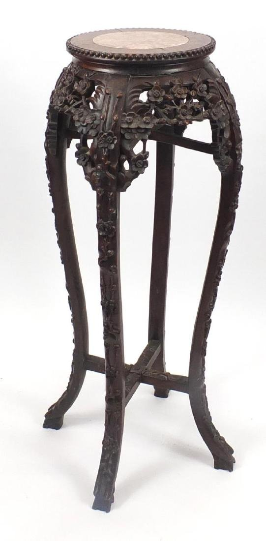 Chinese hardwood plant stand with inset marble top, carved with flower heads, 92cm high Further