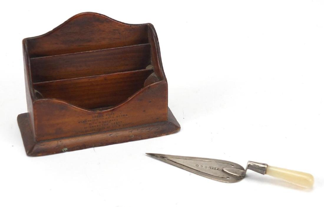 Miniature Mauchline Ware letter rack with Sir Walter Scott's Tomb design together with a silver