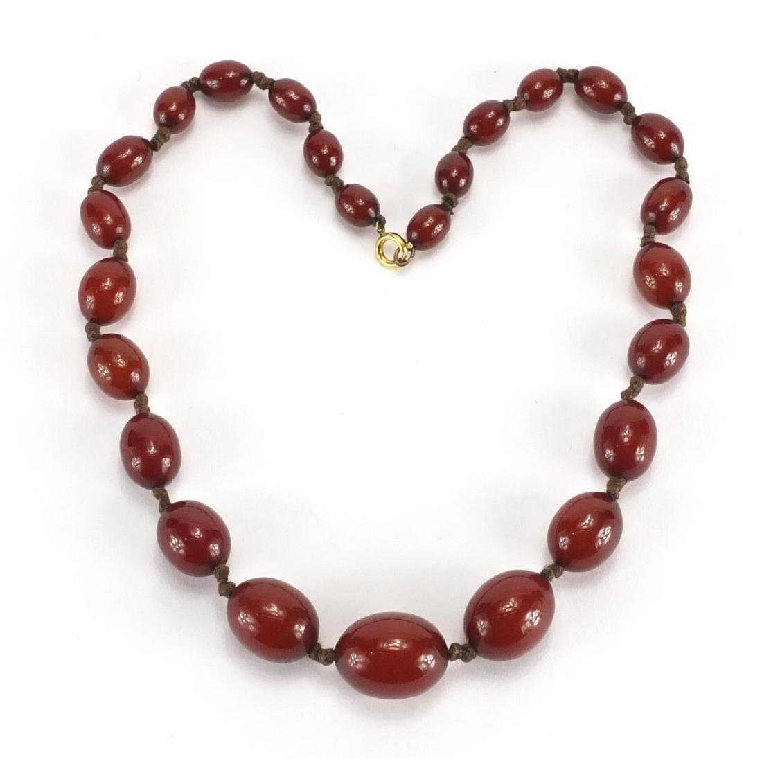 Cherry amber coloured bead necklace, 44cm in length, approximate weight 37.2g Further condition