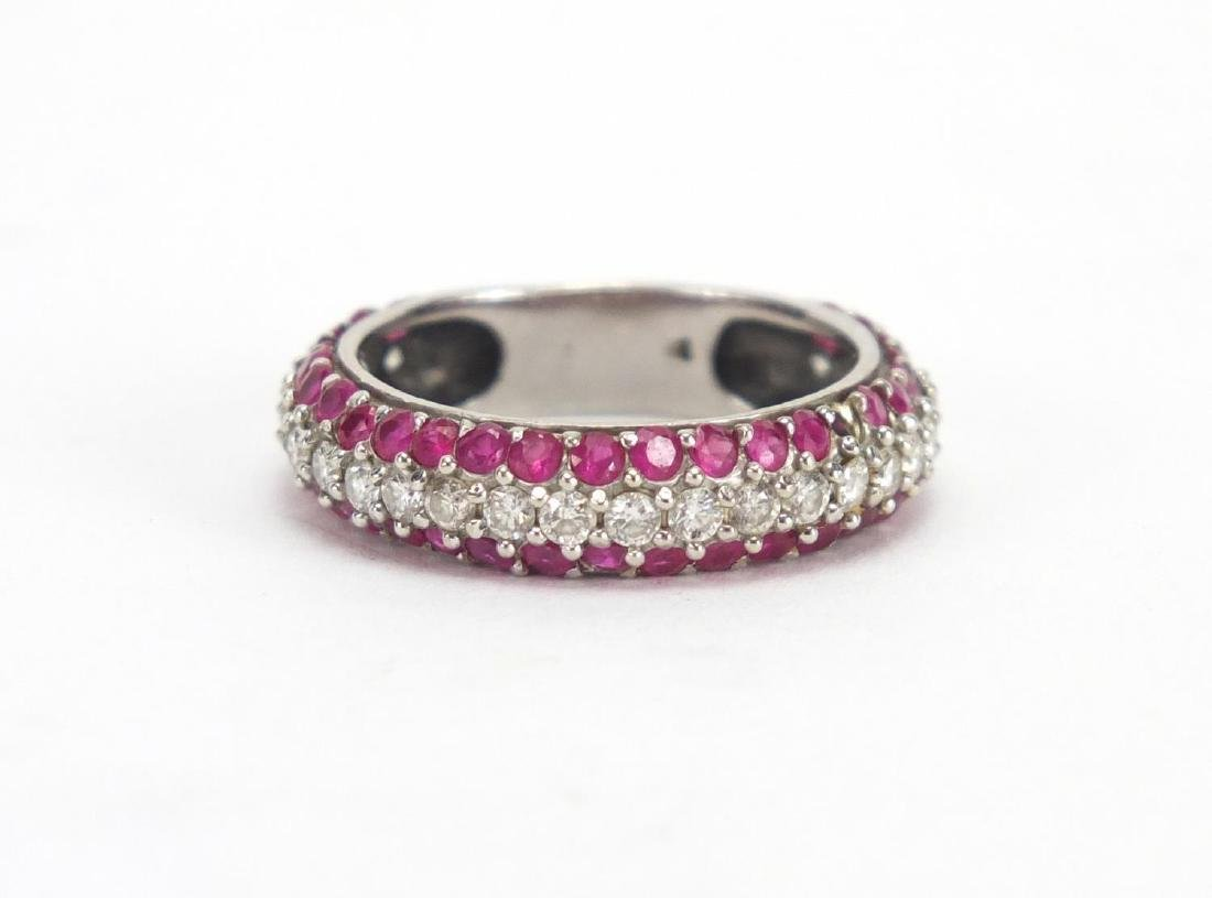 Unmarked white metal Diamond and Ruby half eternity ring, size P, approximate weight 4.5g The Ruby's