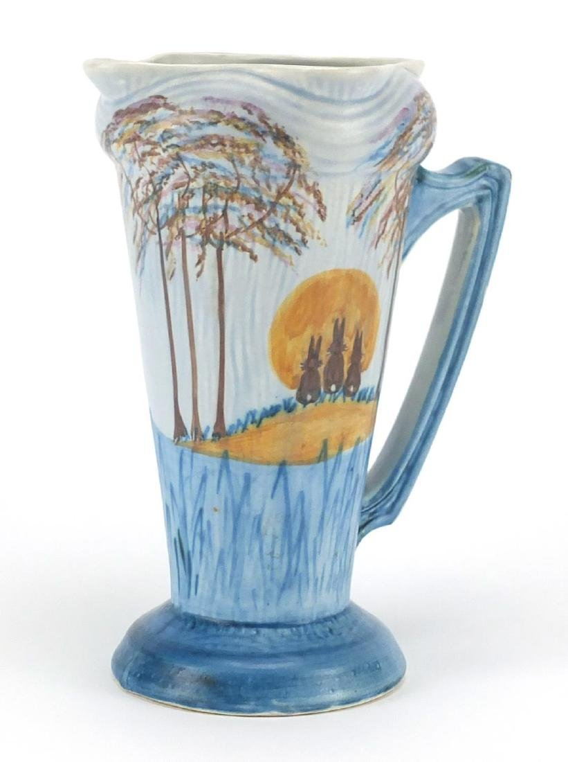 Klaxman Ware jug hand painted with three bunnies in a landscape, factory marks and numbered 208 to