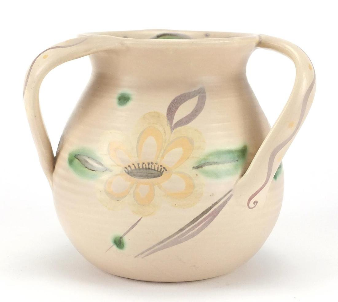 Trial Susie Cooper three handled pottery tyg hand painted with stylised flower heads and leaves,