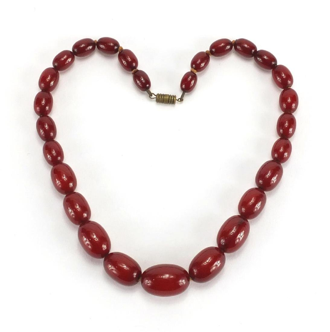 Cherry amber coloured bead necklace, 40cm in length, approximate weight 35.2g Further condition