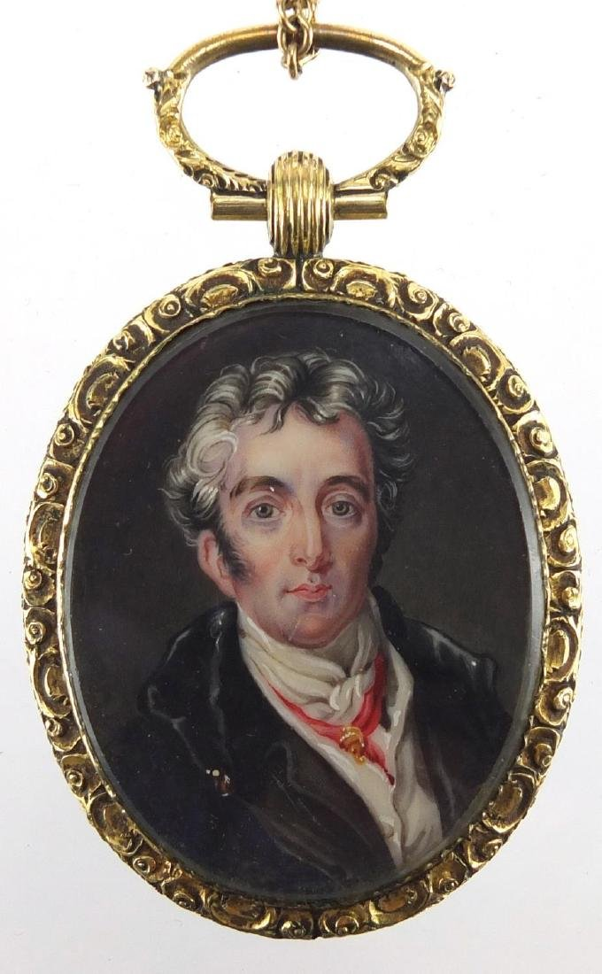19th century oval hand painted portrait miniature of a gentleman, housed in a gilt metal locket