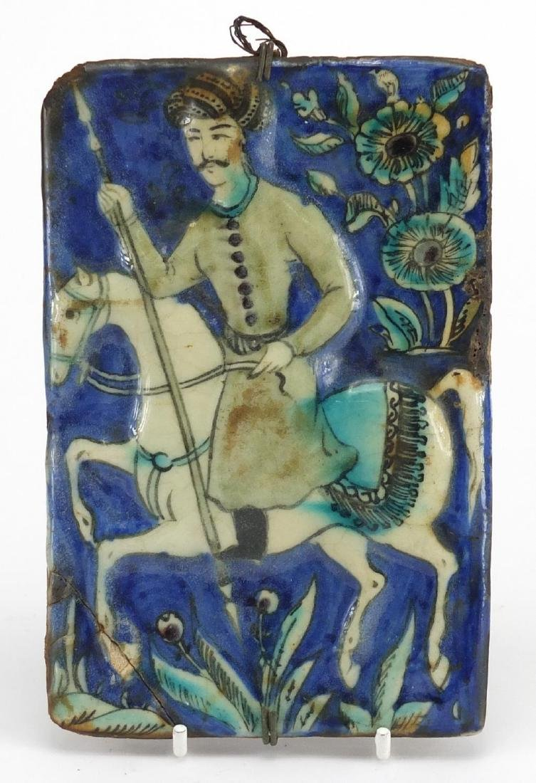 Rectangular Islamic pottery tile hand painted with a figure of horseback, 18cm x 12cm Further