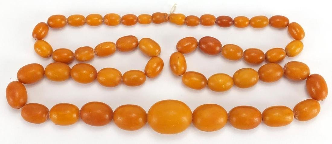 Butterscotch amber bead necklace, 86cm in length, approximate weight 99.8g Further condition reports