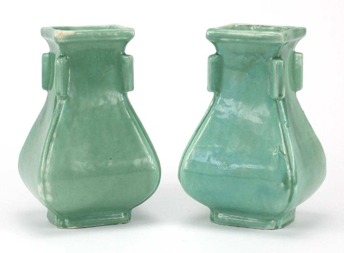 Pair of C H Brannam celadon glazed vases, in the Chinese style both with impressed marks to the