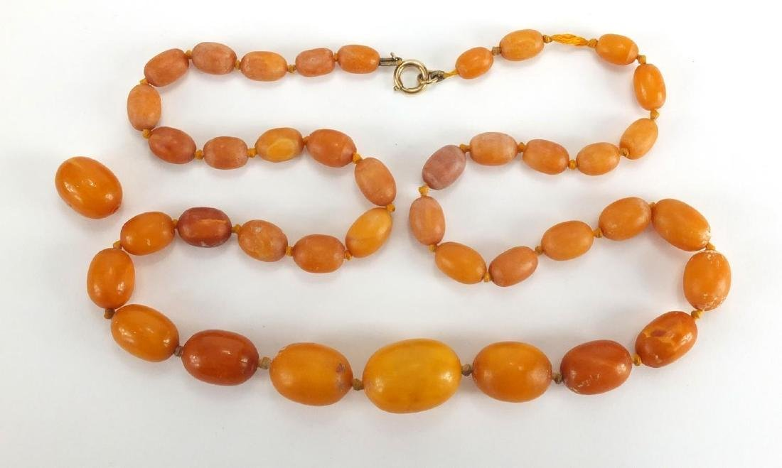 Butterscotch amber coloured bead necklace, 62cm in length, approximate weight 55.8g Further