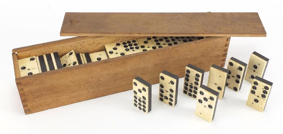 Set of twelve bone and ebony dominoes with box, each domino 5cm x 2.5cm Further condition reports
