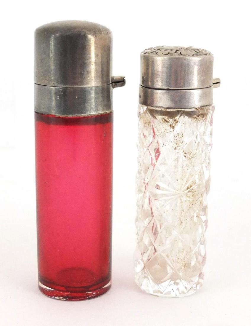 Victorian Cranberry glass silver topped scent bottle with silver lid and one other, hallmarked