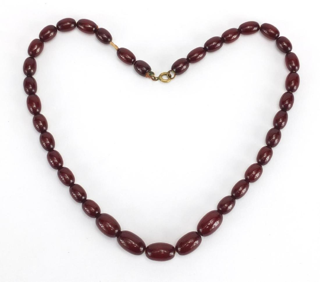 Cherry amber coloured bead necklace, 42cm in length, approximate weight 19.2g Further condition