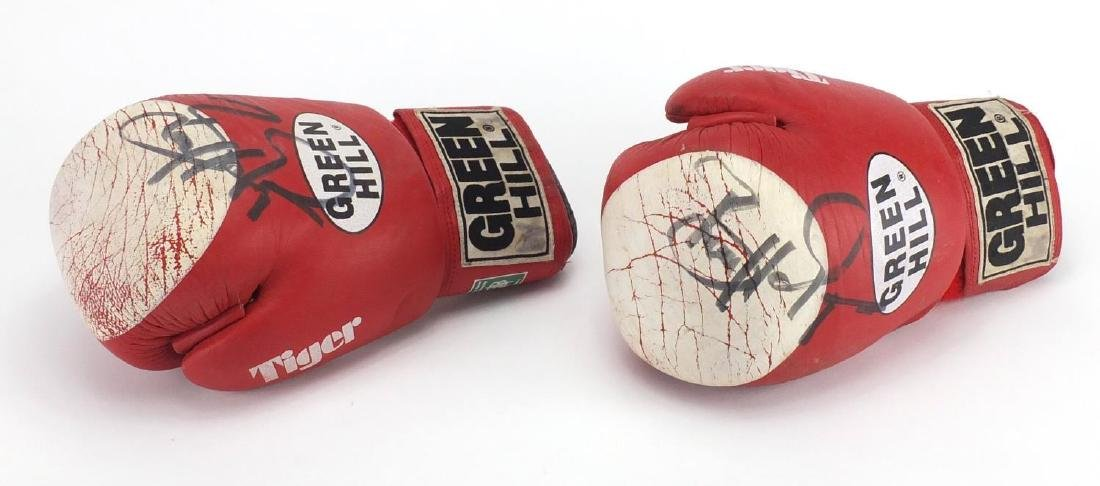 Two signed Greenhill boxing gloves Further condition reports can be found at the auctioneers
