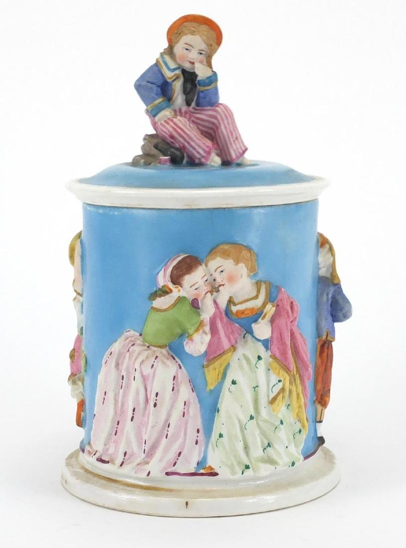 19th century porcelain sailor boy tobacco jar and cover, decorated in relief with continuous band of