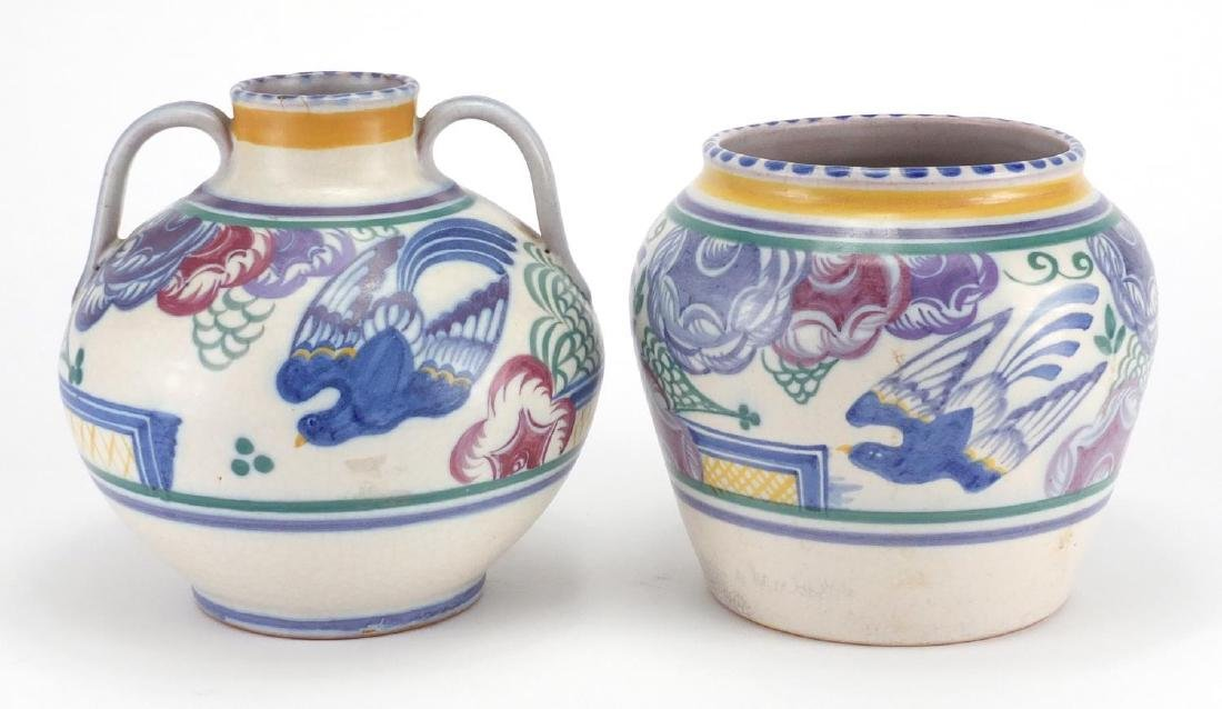 Two Poole pottery Bluebird patterned vases, one of ovoid form with twin handles, both with factory