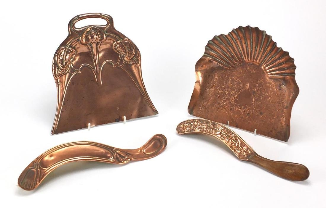 Arts & Crafts copper comprising two hand brushes and two trays, embossed and engraved with
