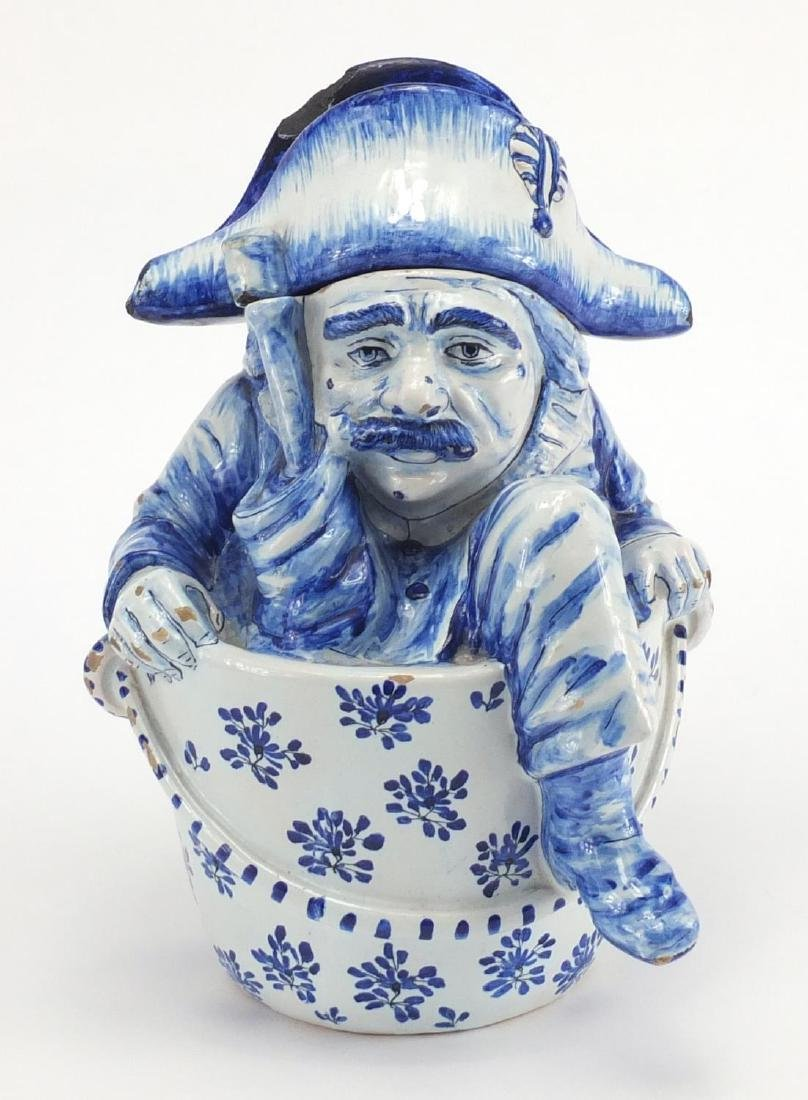 Delft blue and white pottery figural jar and cover, 27cm high Further condition reports can be found