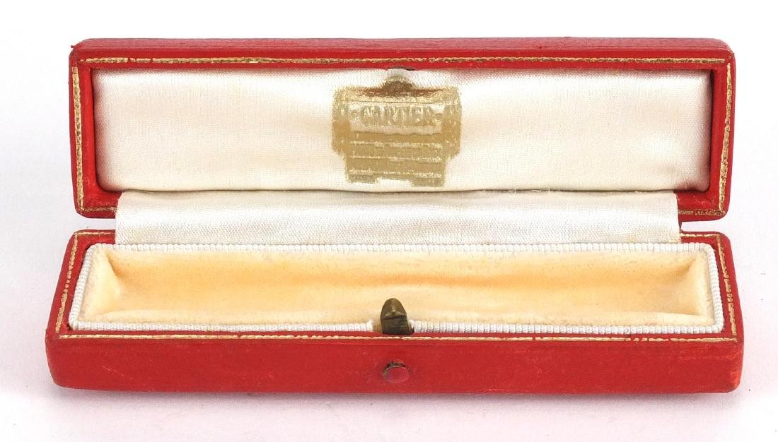 Vintage Cartier tooled leather jewellery box with silk lined interior, 10.5cm wide Further condition