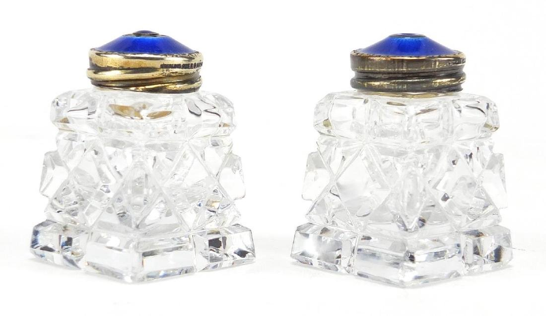 Pair of Norwegian 925 sterling silver and enamel cut glass salt and peppers, each 4.5cm high Further