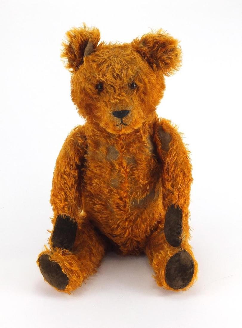 Vintage golden straw filled teddy bear with jointed limbs and beaded glass eyes, 65cm high Further