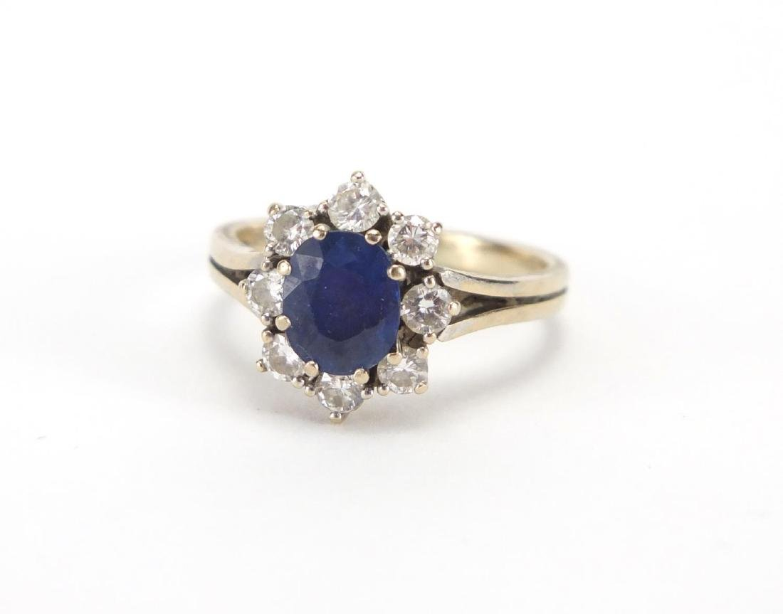 18ct white gold sapphire and diamond ring, size O, approximate weight 4.5g Further condition reports