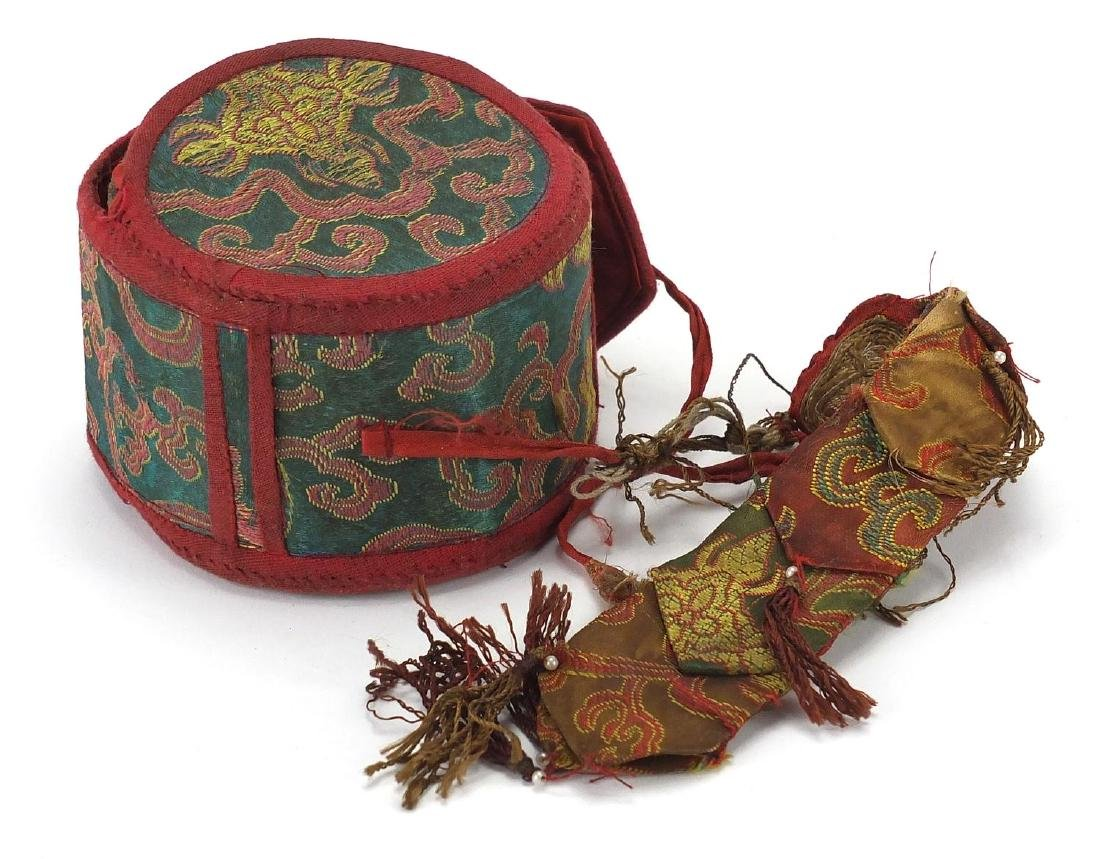 Tibetan wooden prayer drum with embroidered cloth case, 11cm in diameter Further condition reports