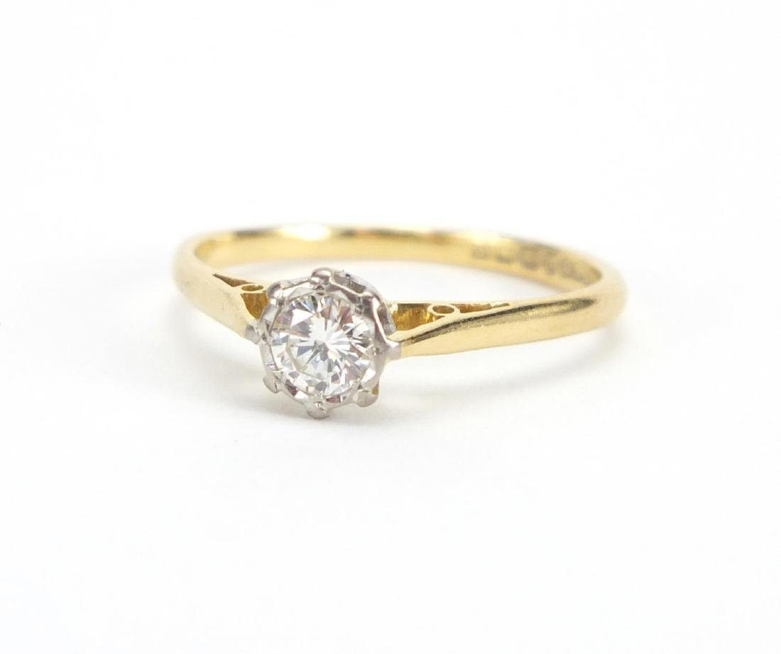 18ct gold Diamond solitaire ring, size R, approximate weight 2.6g The Diamond is modern round
