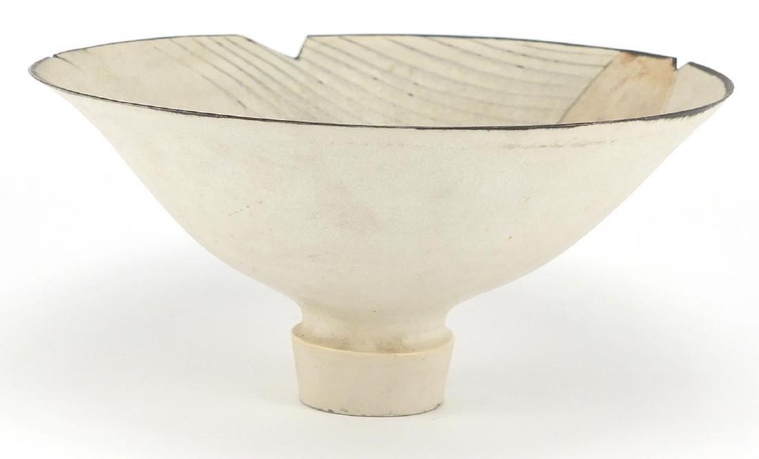 David Howard Jones Raku footed bowl with flared rim, incised initials around the foot rim, 20.5cm in
