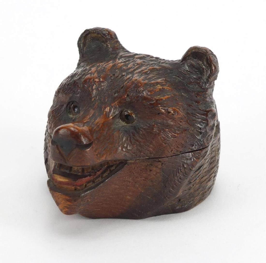Swiss Black forest carved wooden bears head stamp box, with beaded eyes, 9cm in length Further