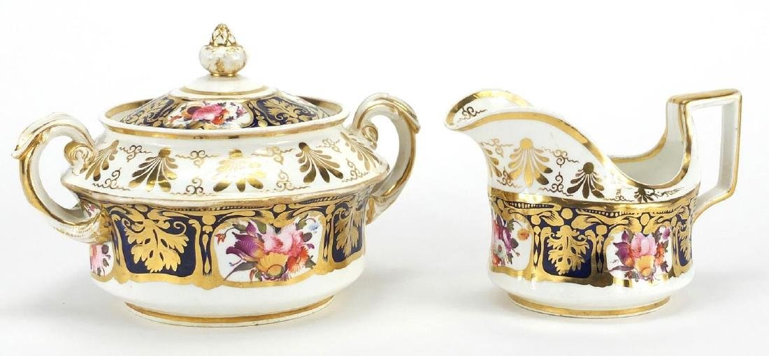 19th century Coalport porcelain sucrier and milk jug, hand painted and gilded with panels of