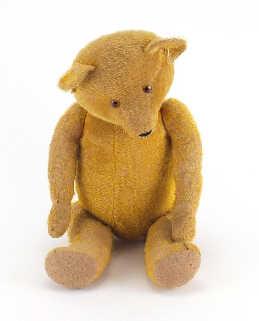 Vintage golden straw filled teddy bear with jointed limbs and beaded glass eyes, 62cm high Further