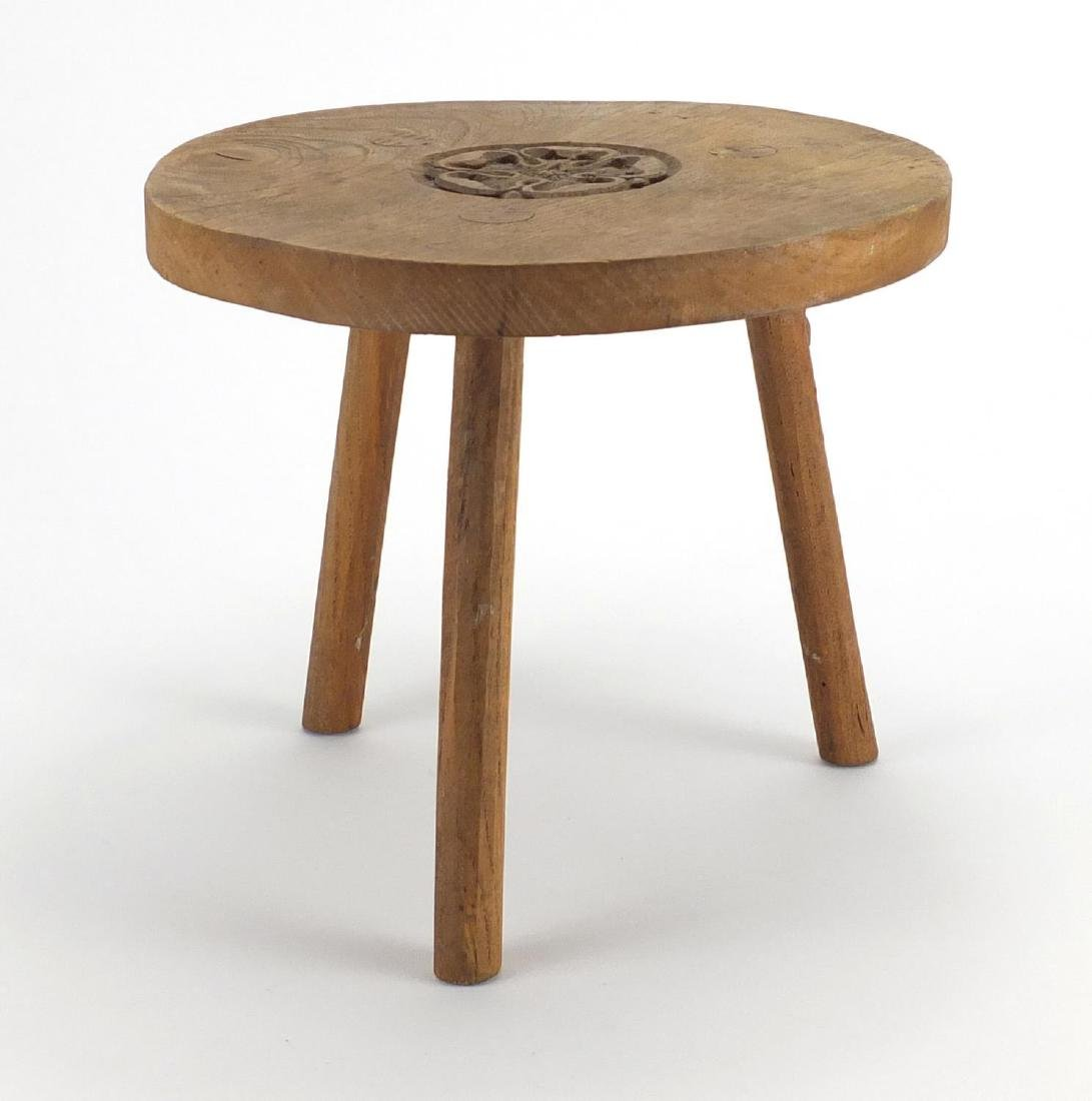 Robert Mouseman Thompson light oak three legged stool, carved with a signature mouse, 23cm high x